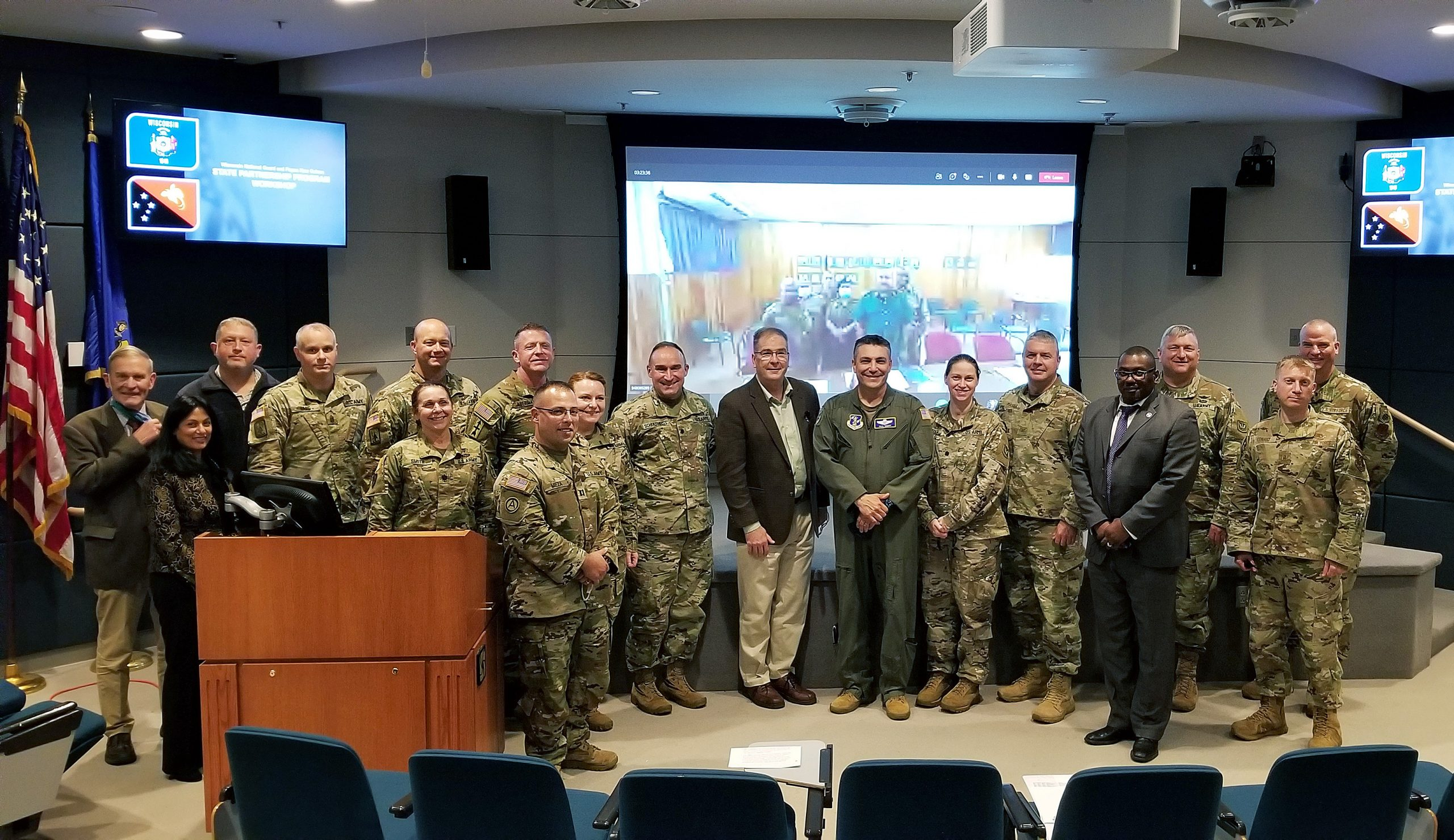 A May 27 group photo of participants in the three-day State Partnership Program workshop between Wisconsin, in the foreground, and Papua New Guinea, on screen. The State Partnership Program links individual states with armed forces of partner nations around the world to forge lasting cooperation, friendship, and mutually beneficial relationships. The 32nd Division, which included most of the Wisconsin National Guard at the time, fought the Japanese in Papua New Guinea during World War II. Wisconsin Department of Military Affairs photo by Katie Reinfeld