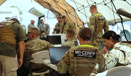 Members of the Wisconsin Chemical Biological Radiological Nuclear Enhanced Response Force Package (CERF-P) logistics team conduct operations during their external evaluation Aug. 17 at Volk Field, Wis. The CERF-P is evaluated every two years in order to maintain and validate its readiness for a worst-case scenario. Wisconsin National Guard photo by Sgt. Amber Peck