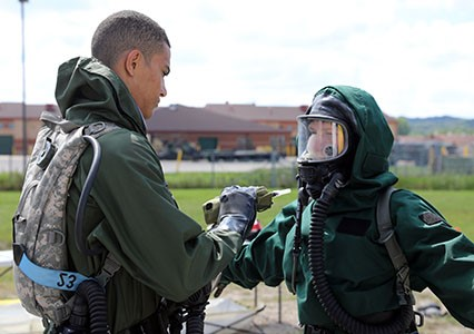 Members of the Wisconsin Chemical Biological Radiological Nuclear Enhanced Response Force Package (CERF-P) decontamination team conduct operations during an external evaluation Aug. 17 at Volk Field, Wis. The CERF-P is evaluated every two years in order to maintain and validate its readiness for a worst-case scenario. Wisconsin National Guard photo by Sgt. Amber Peck