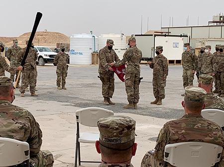 The Wisconsin Army National Guard's 135th Medical Company uncase their guidon during a transfer of authority ceremony May 24. The 135th is serving at Al Asad Air Base in western Iraq as well as multiple locations in the Middle East in support of Operation Spartan Shield. Their role is to provide basic secondary health care and stabilize post-surgical cases for medical evacuation. Submitted photo